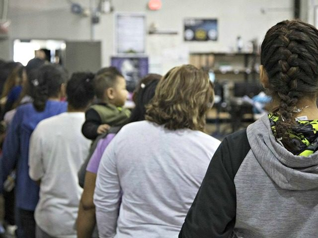 illegal-immigrants-line-up-US-Customs-and-Border-Patrol-640x480