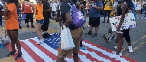 Black Lives Matter protesters filmed dancing on American flag