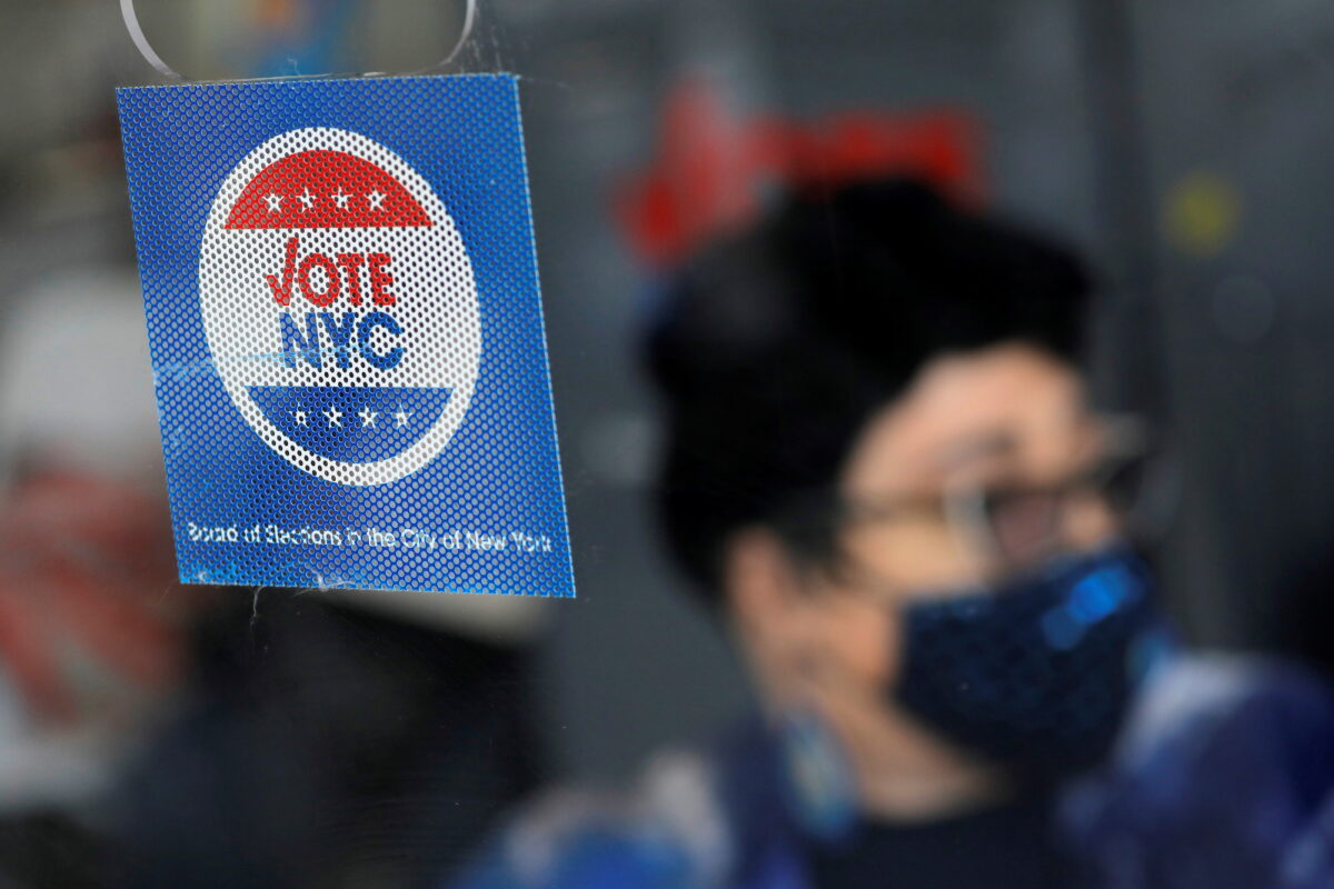 Signage is seen at an early voting location ahead of the New York City mayoral election in Harlem, New York City